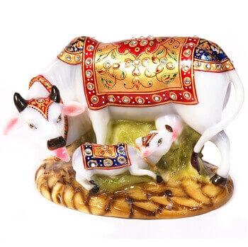 Picture of Decorative cow and calf statue made of soft marble fiber for a vastu makeover